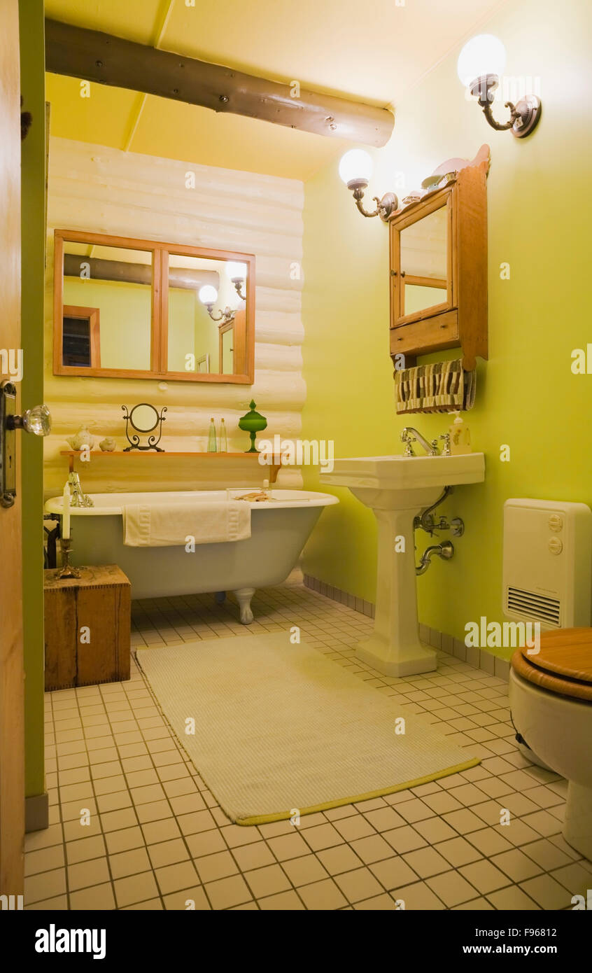 Guest Bathroom Wirh A Roll Top Bathtub Inside Country Cottage Style Residential Log Home Quebec Canada This Image Is