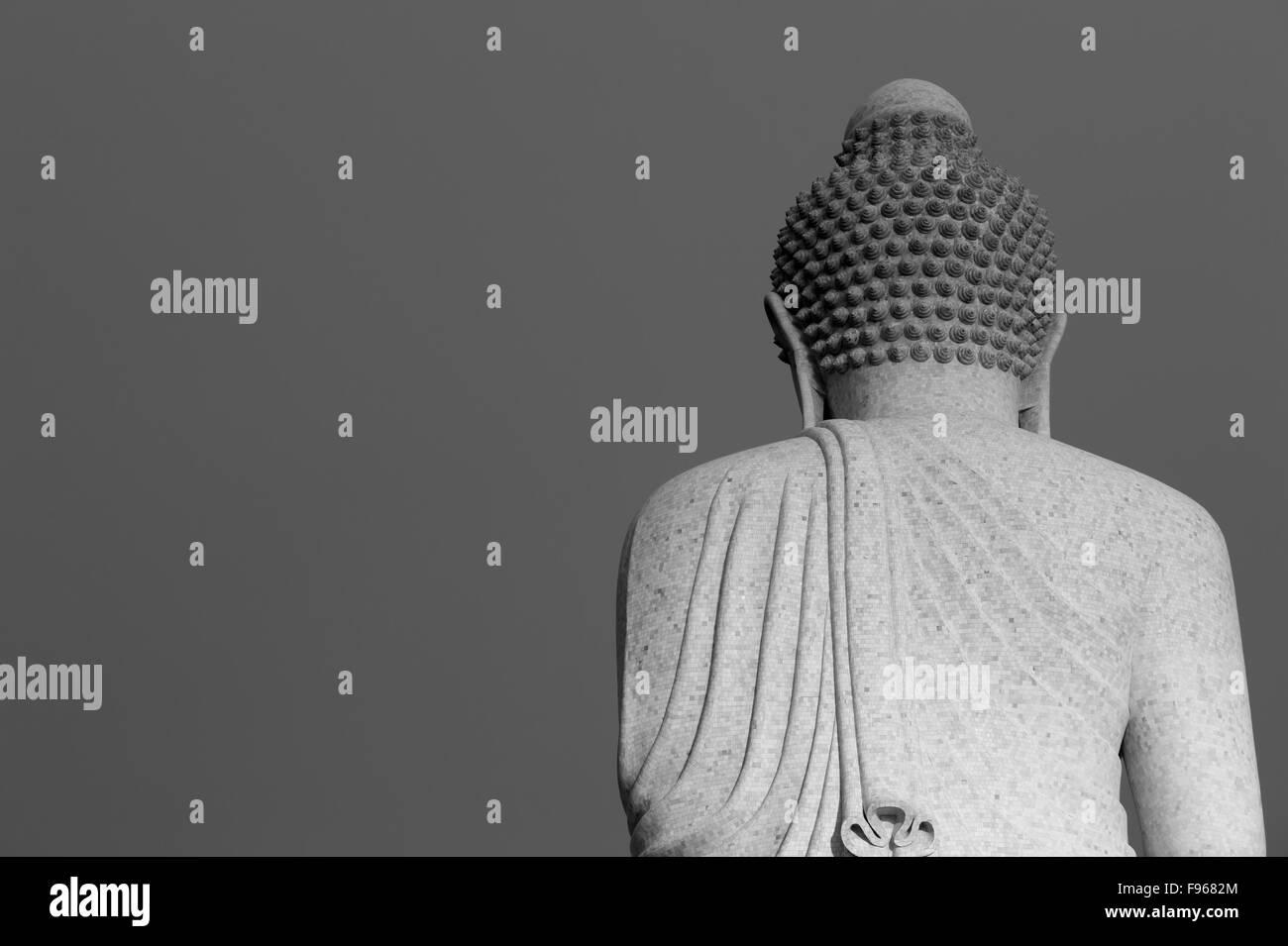 Behind big buddha - Stock Image