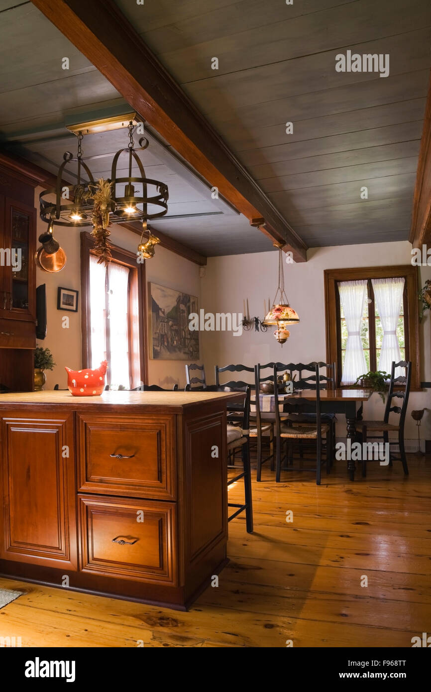 Kitchen Island And An Old Wooden Dining Table With Highback