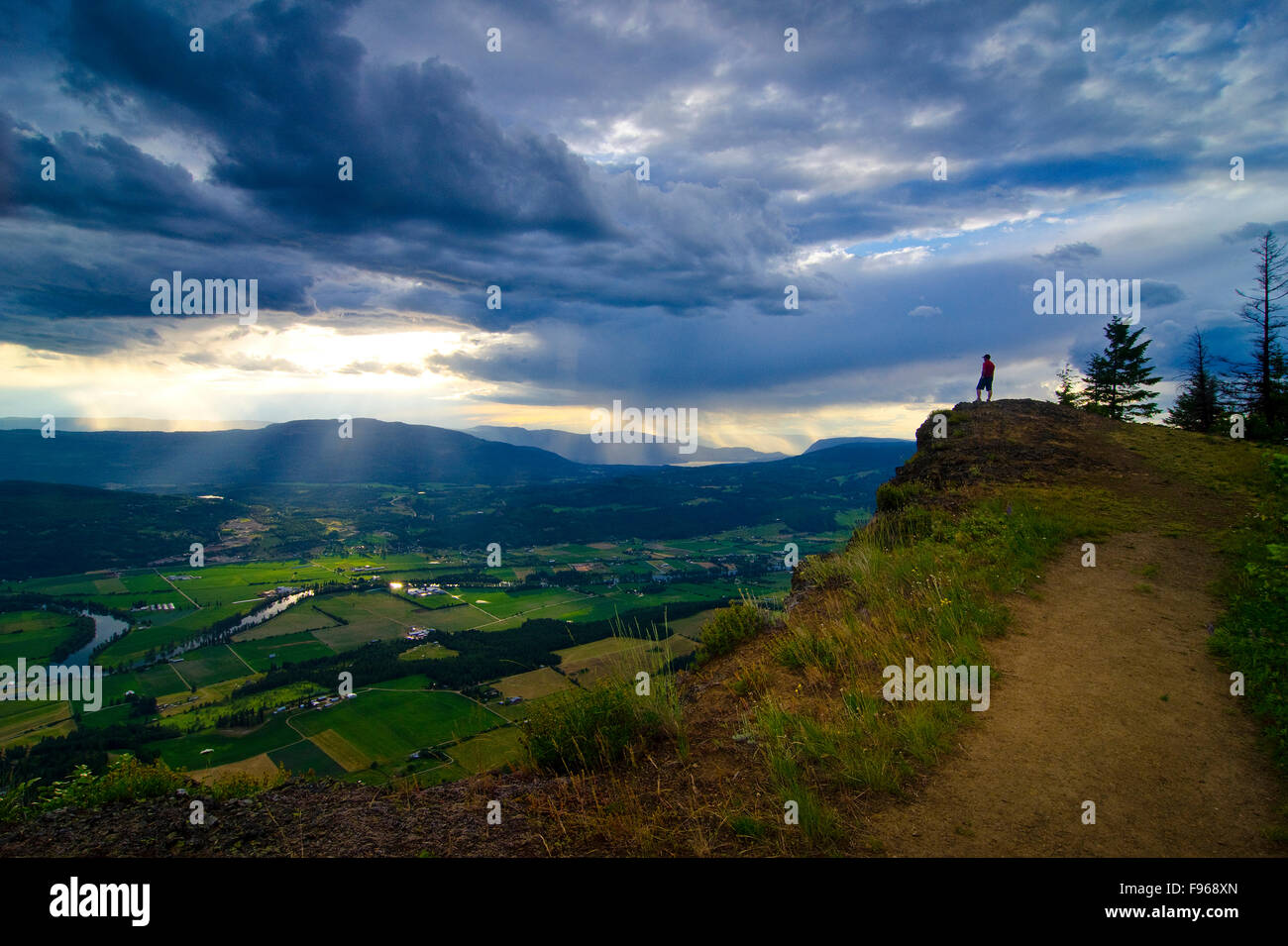Hiker revels in the view after a challenging, yet rewarding hike to the top of the Enderby Cliffs, overlooking Enderby, - Stock Image