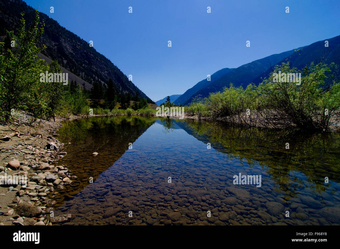 The shapes and curves of the rugged terrain along the Similkameen River, near Keremeos, in the Simikameen region - Stock Image