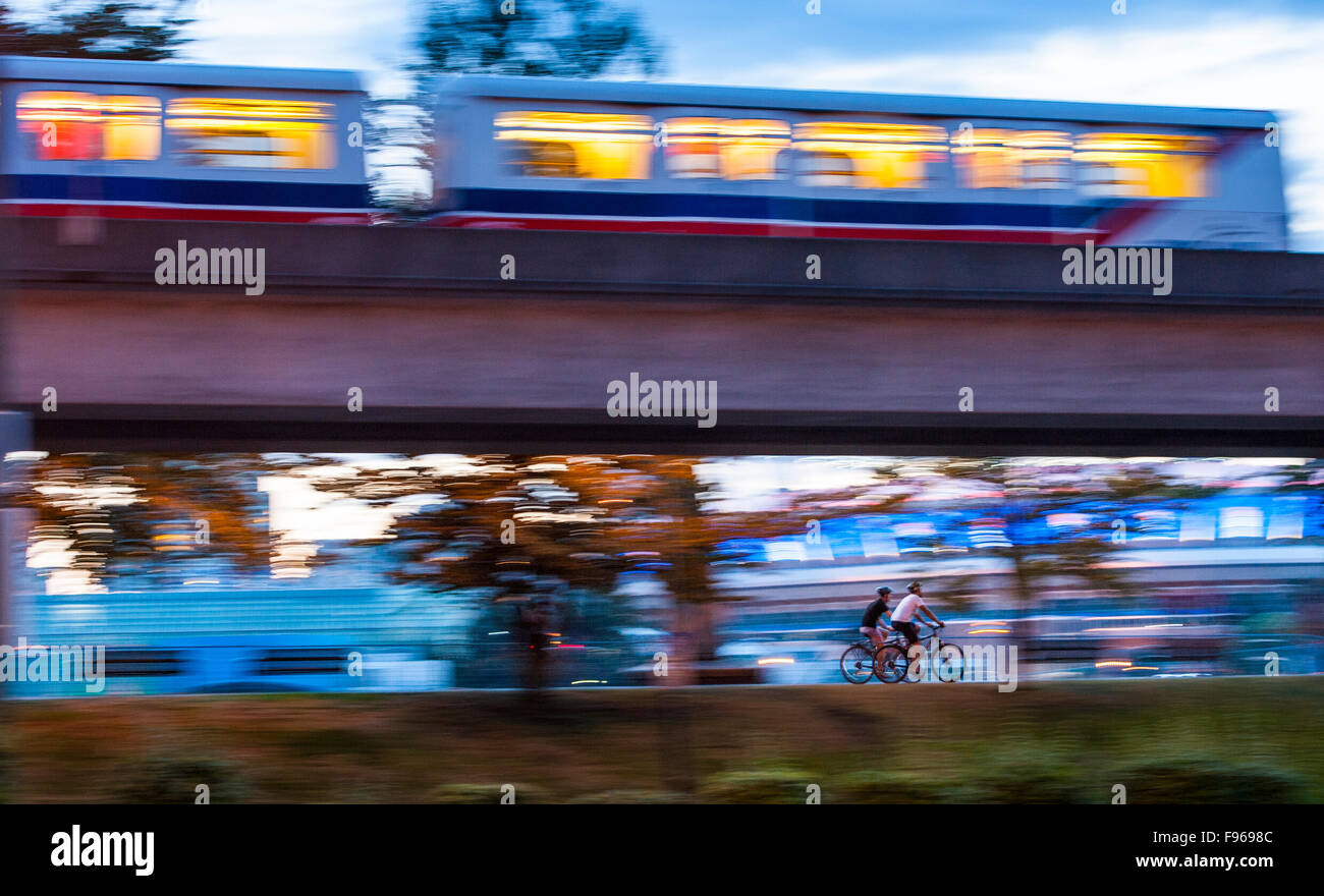Bicyclists and Skytrain, Vancouver, British Columbia, Canada Stock Photo