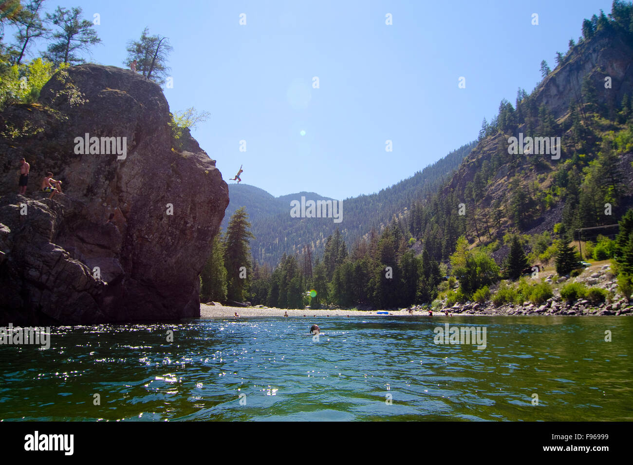 Jumping off Bromley Rock into the Similkameen River, Bromley Rock Provincial Park, near Princeton, British Columbia, - Stock Image