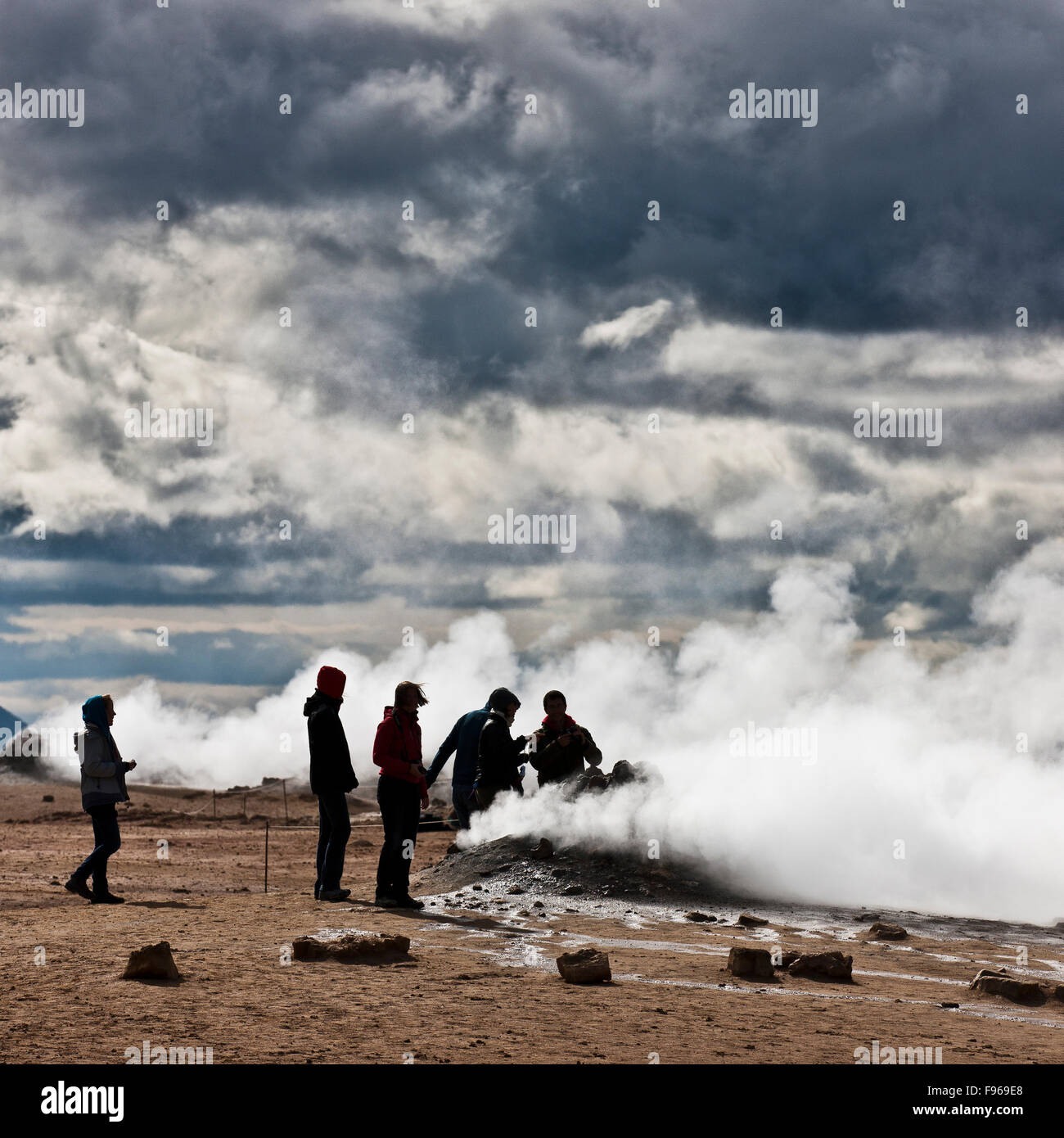 Tourists at geothermal hot springs, Hverarond, Namaskard, Iceland. The area is characterized by boiling mud-bogs Stock Photo