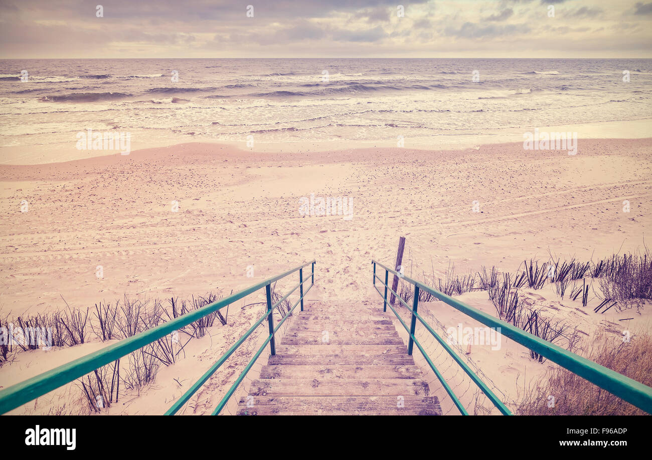 Vintage toned wooden stairs on a beach. Stock Photo