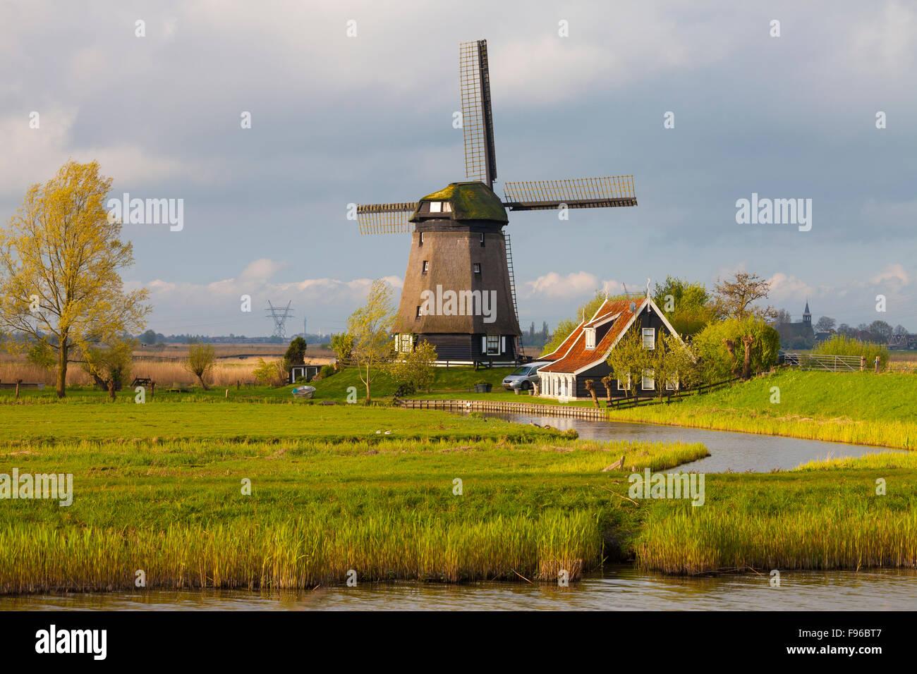 Windmill near Schermerhorn, North Holland, Netherlands - Stock Image