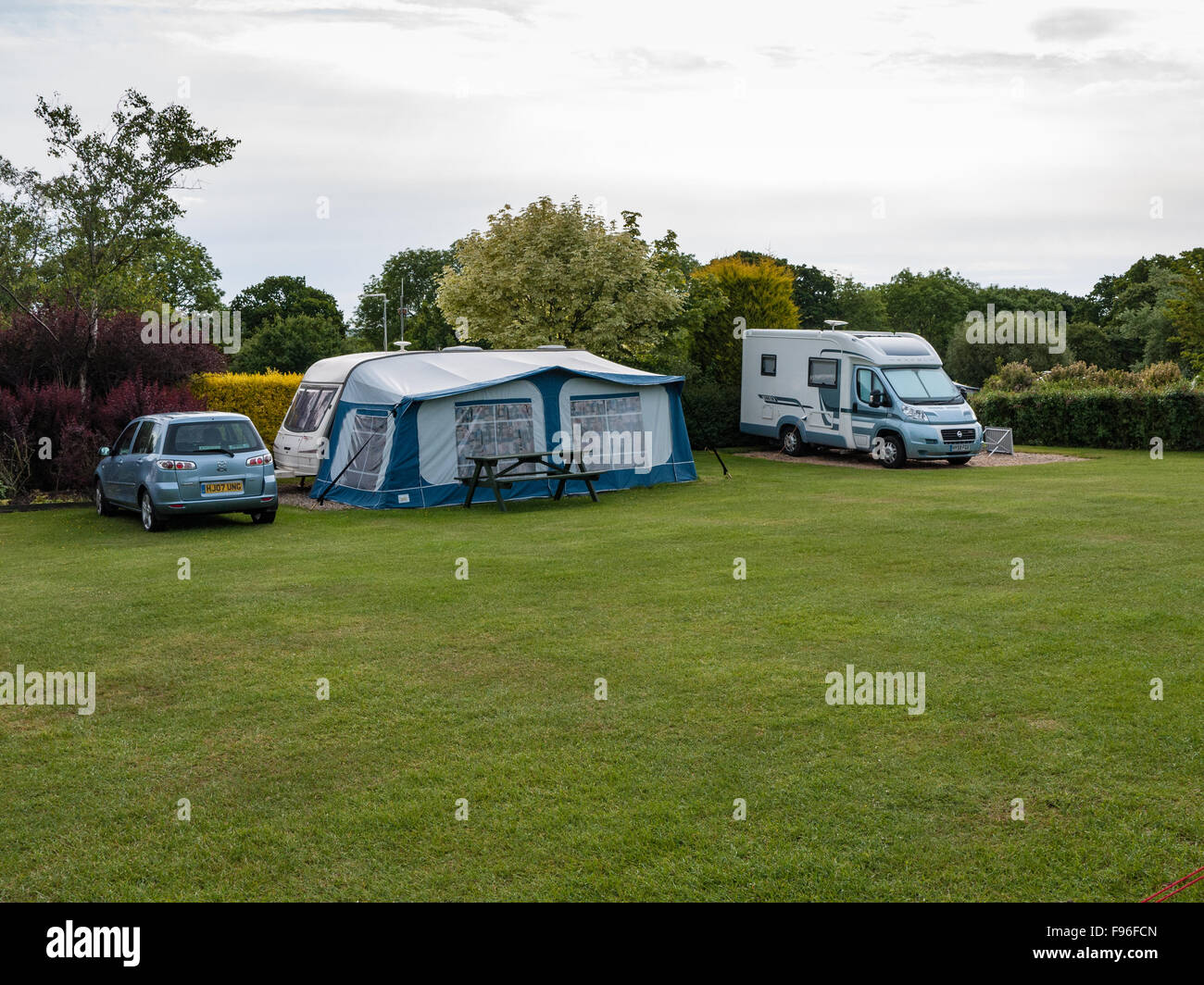 English campsite with caravans and awnings - Stock Image