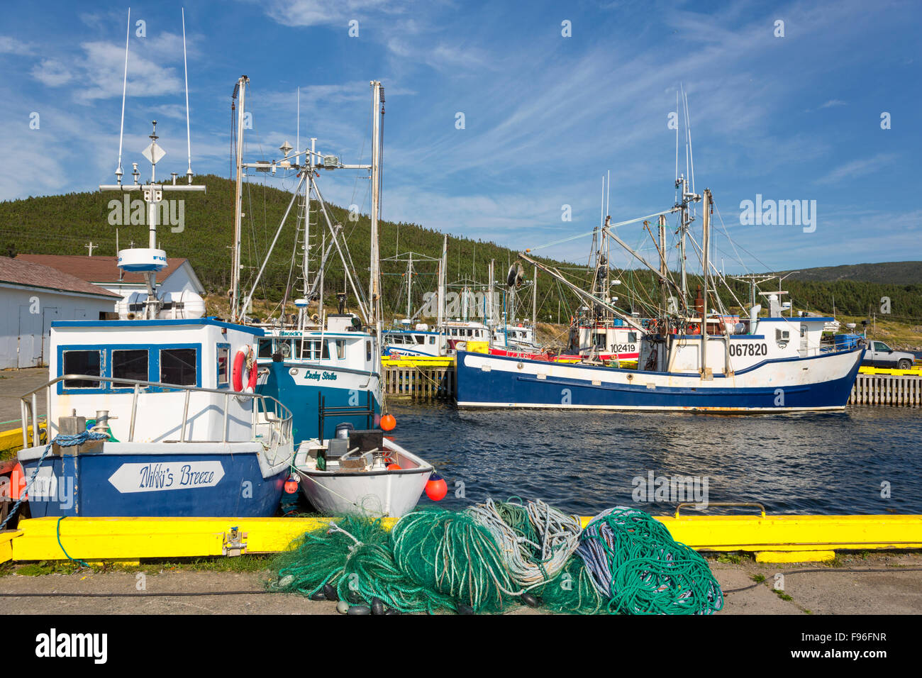 Fishing boats tied up at wharf, Heart's Content, Newfoundland, Canada - Stock Image