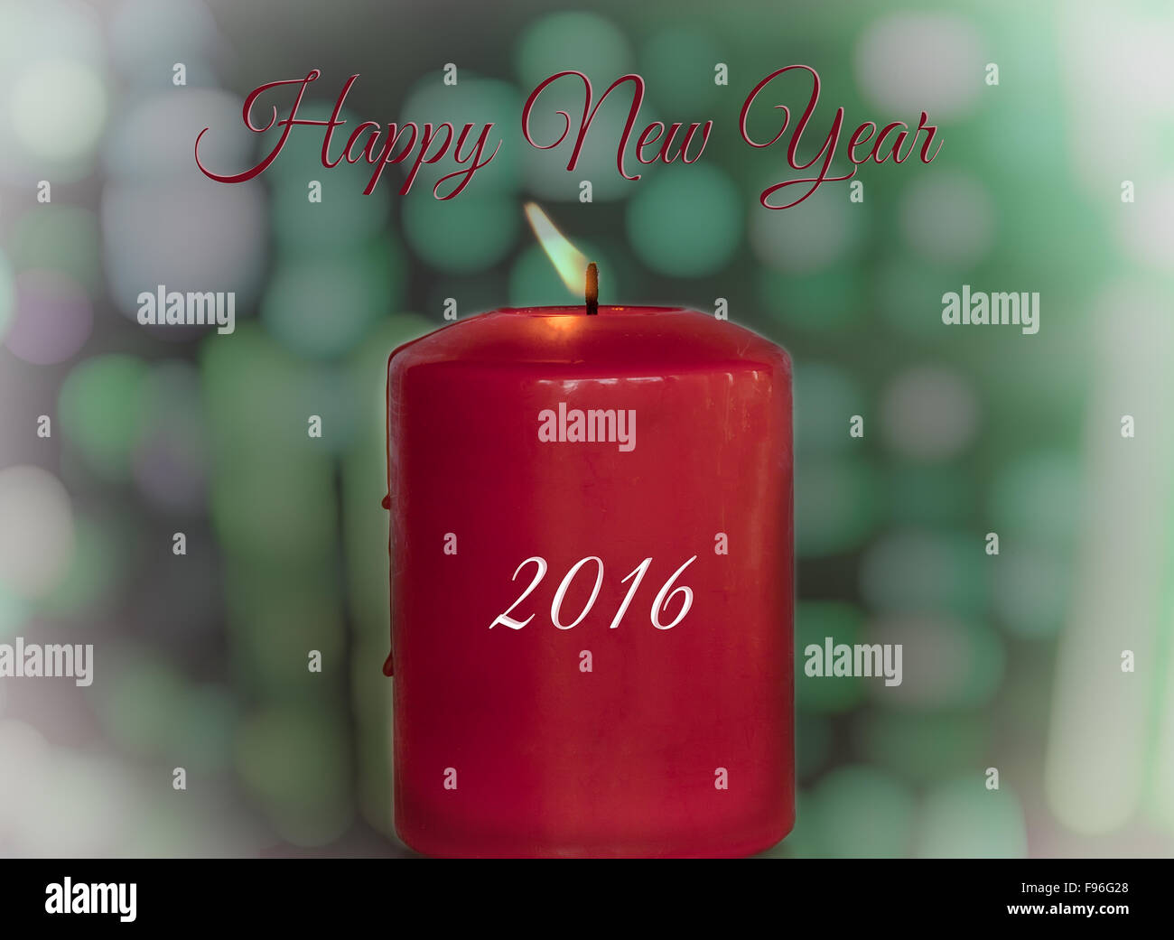 Happy New Year Greeting card with lit candle and the new year 2016. - Stock Image