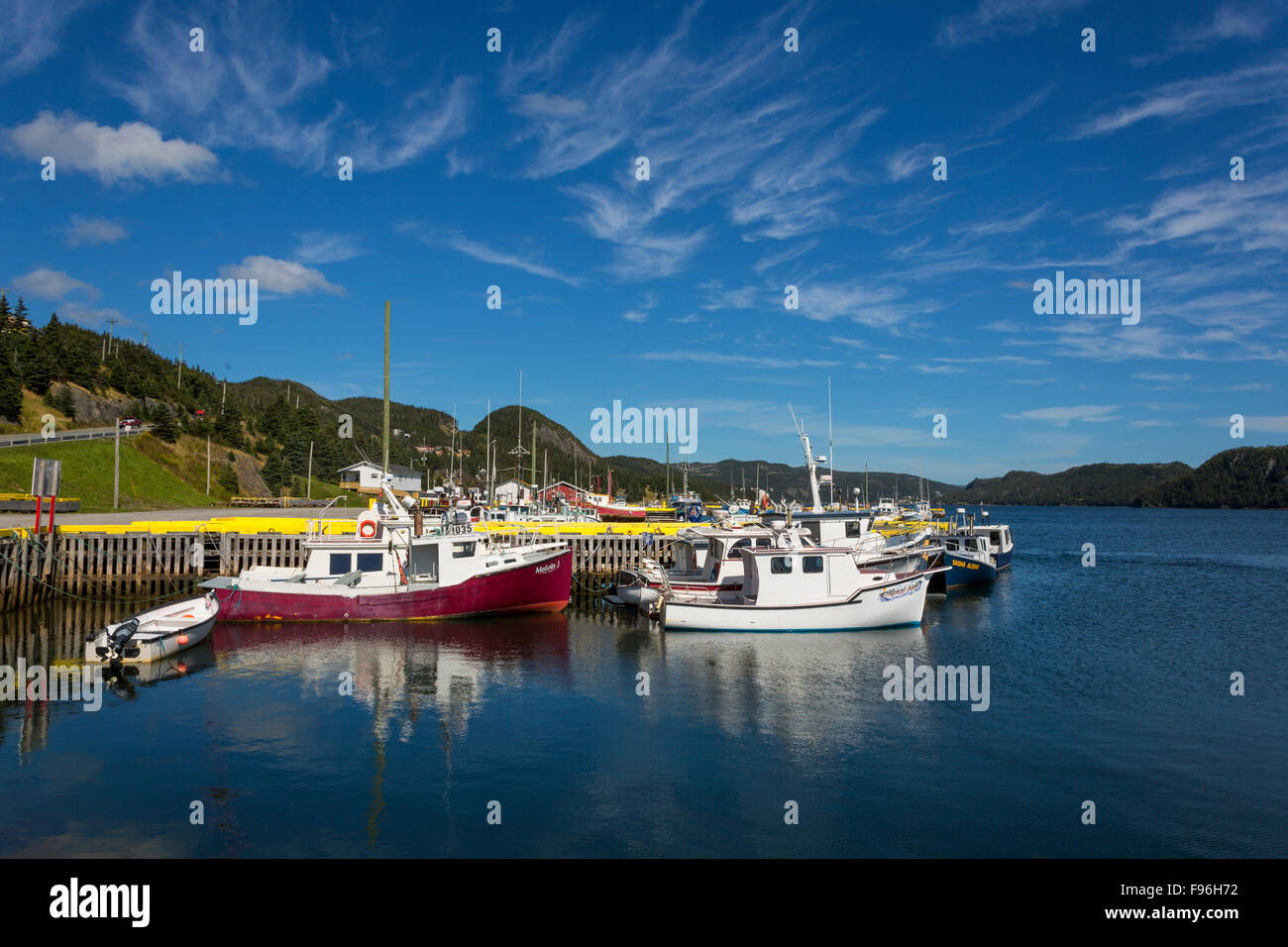 Fishing boats tied up at wharf, St. Bride's Harbour, Newfoundland, Canada - Stock Image