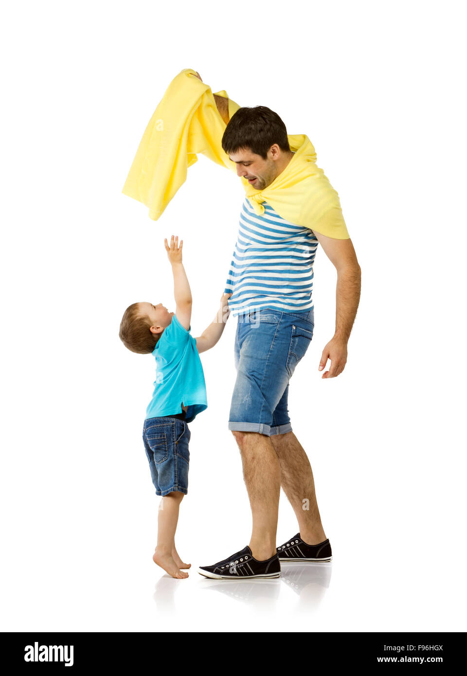 Father as hero with his son isolated on white background - Stock Image