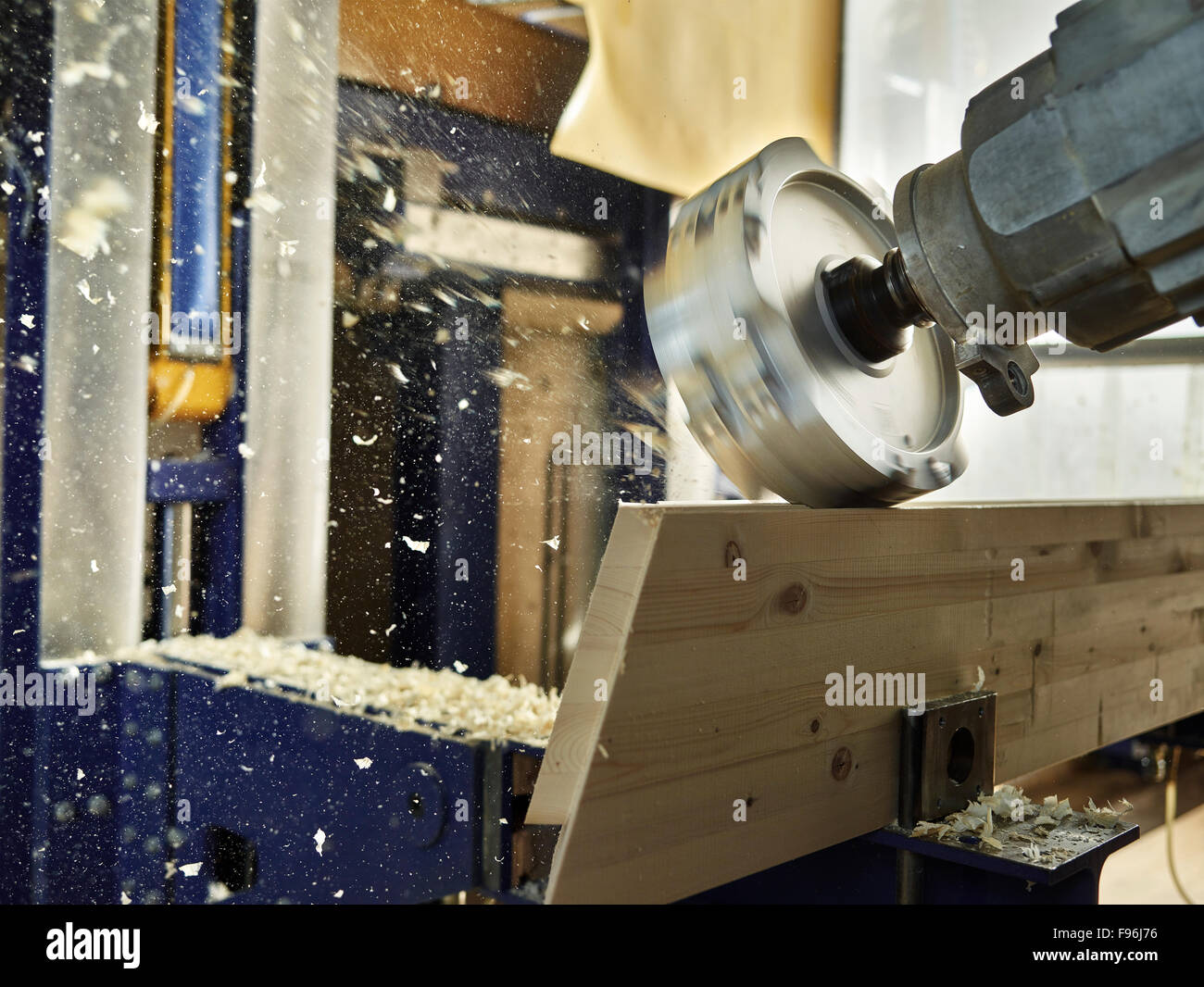 Wood milling machine shaping a wooden board, Austria - Stock Image