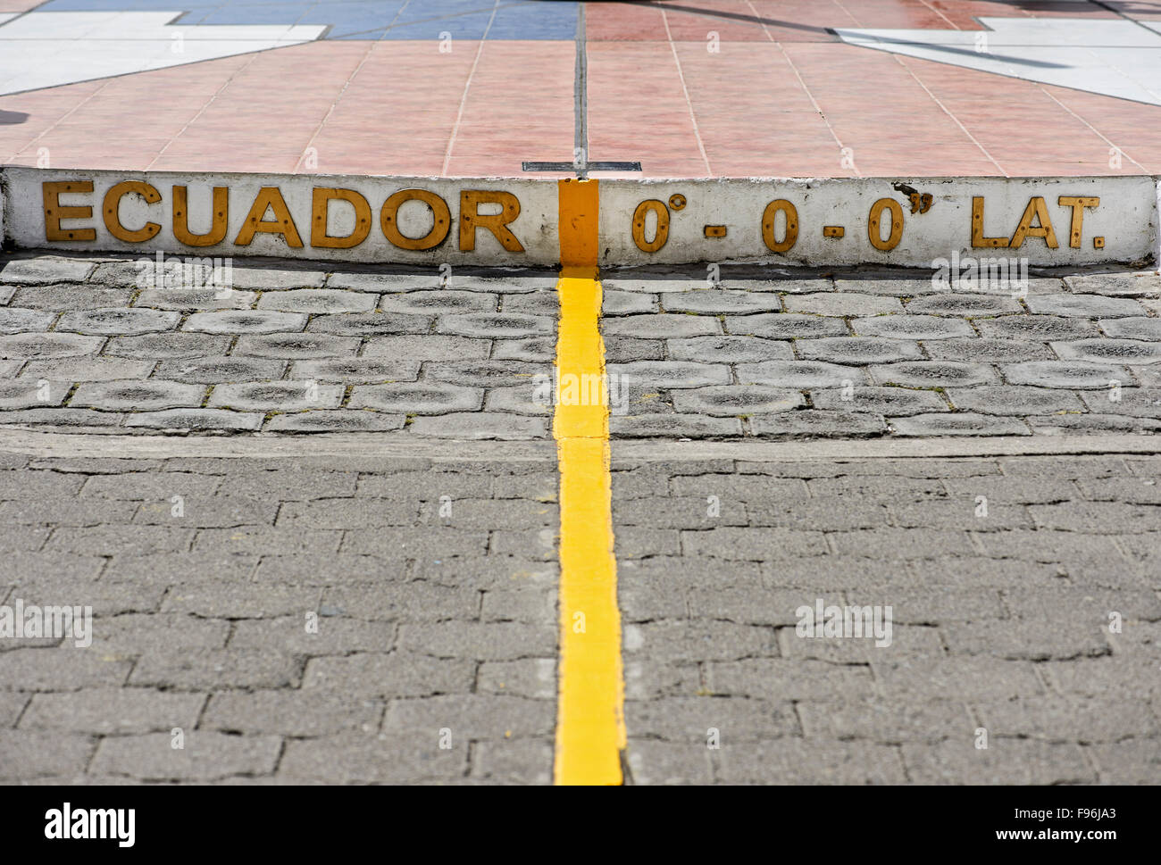 Yellow equator line, marking zero degrees latitude, Equator Monument La Mitad del Mundo, center of the world - Stock Image