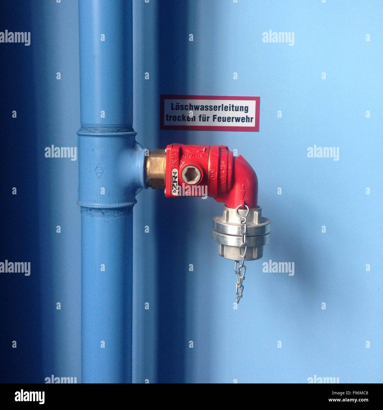 Close-Up Of Fire Pipe Against Wall - Stock Image