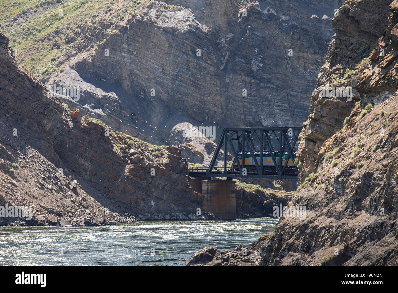 Train locomotive going over a trestle bridge in the Black Canyon near Ashcroft, British Columbia, Canada. - Stock Image