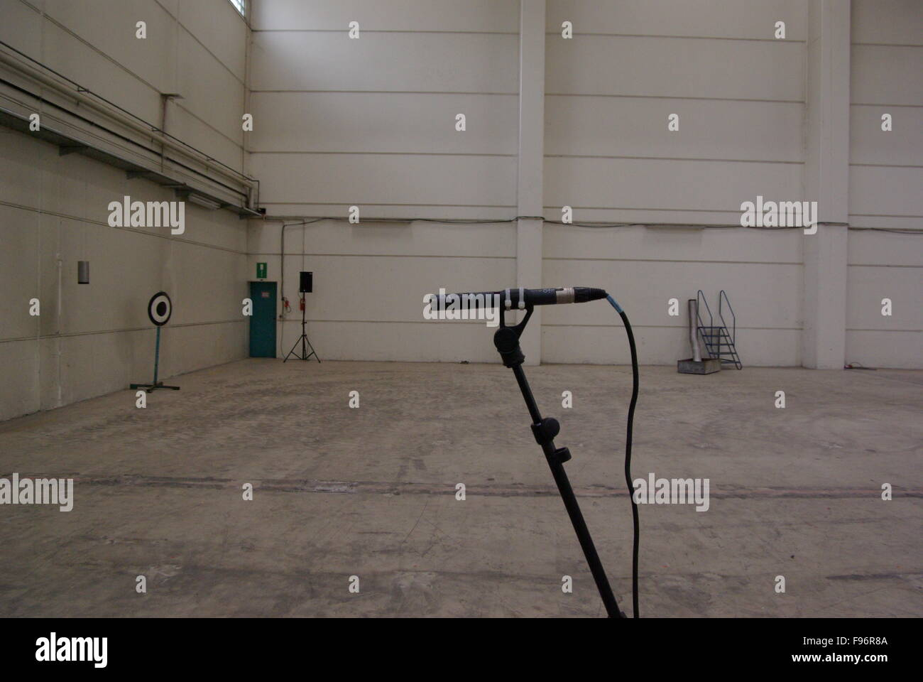 Microphone In Spacious Empty Hall - Stock Image