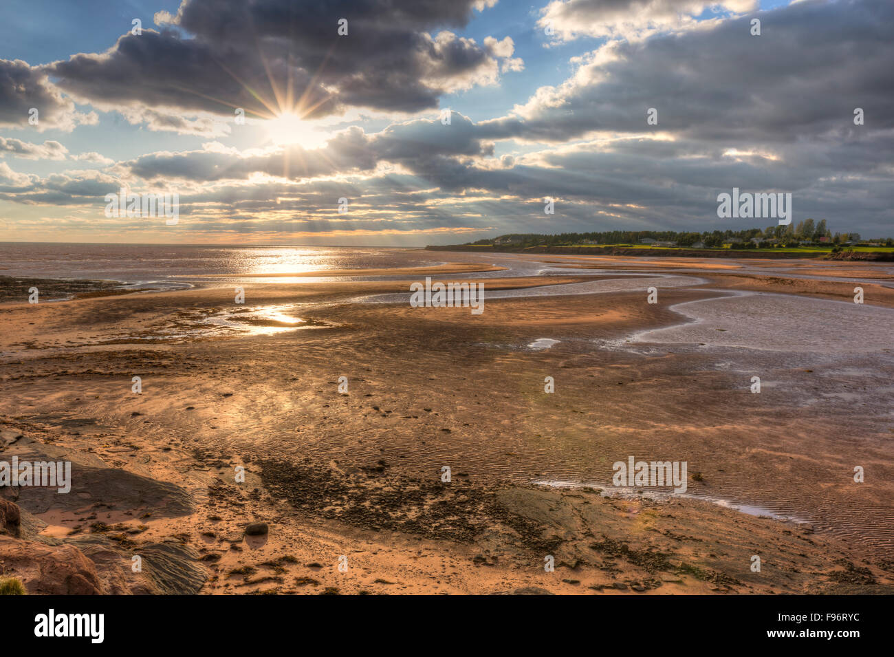 Sunrays breaking throug clouds, Canoe Cove Beach, Prince Edward Island, Canada - Stock Image
