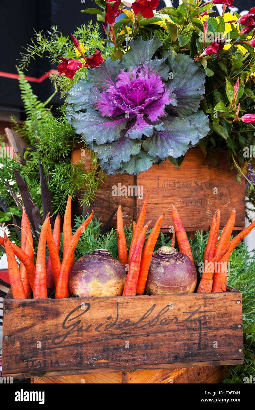 Locally grown vegetables in wooden boxes that form a display outside a restaurant along the Halifax Waterfront, - Stock Image