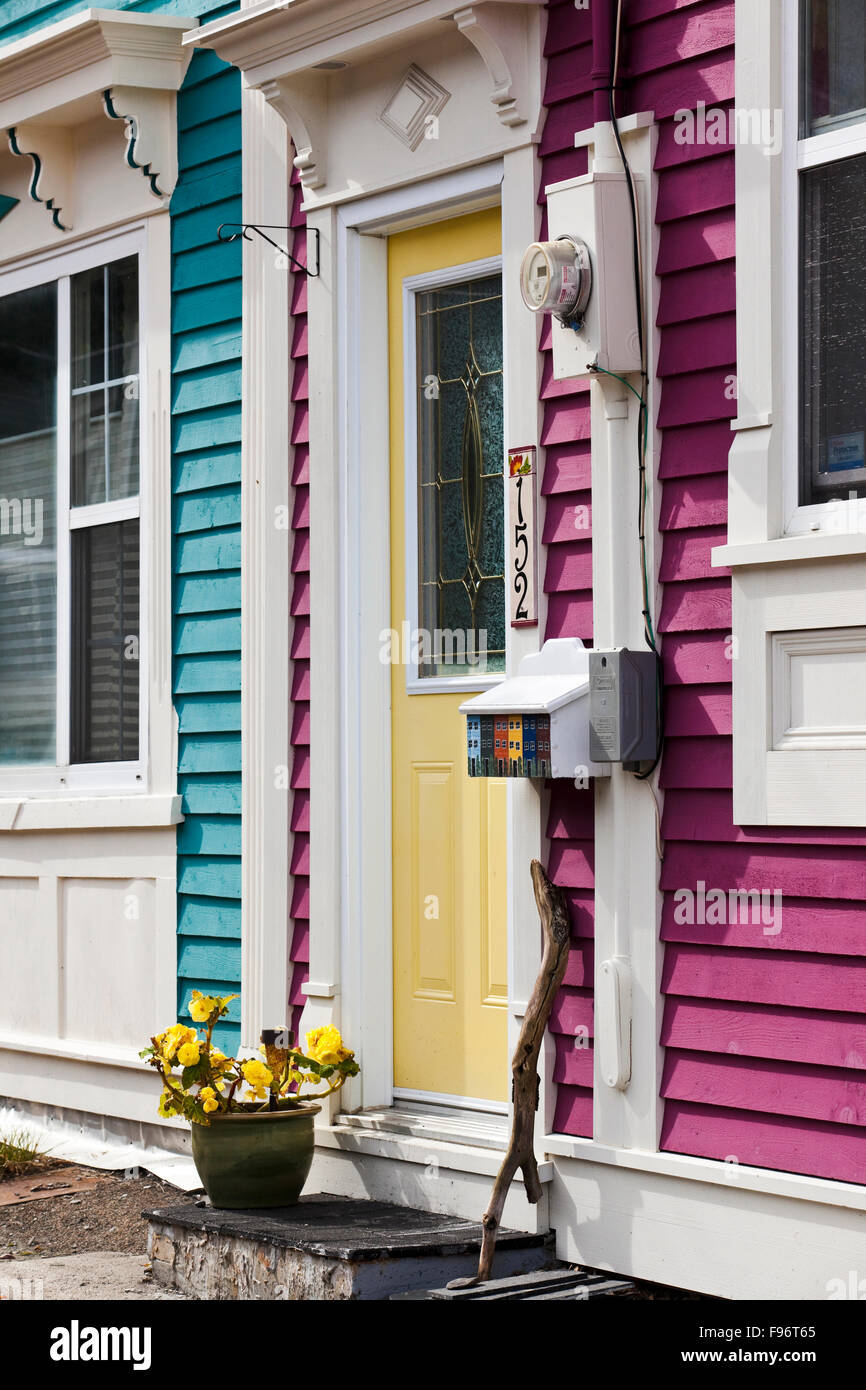Harmonious colours on the facades of two rowhouses in the historic district of St. John's, Newfoundland. The - Stock Image