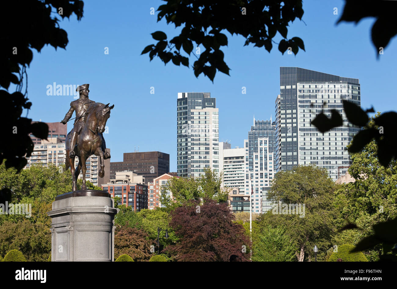 View from west end of Boston Public Garden towards the city centre. The bronze statue on the left is of George Washington - Stock Image