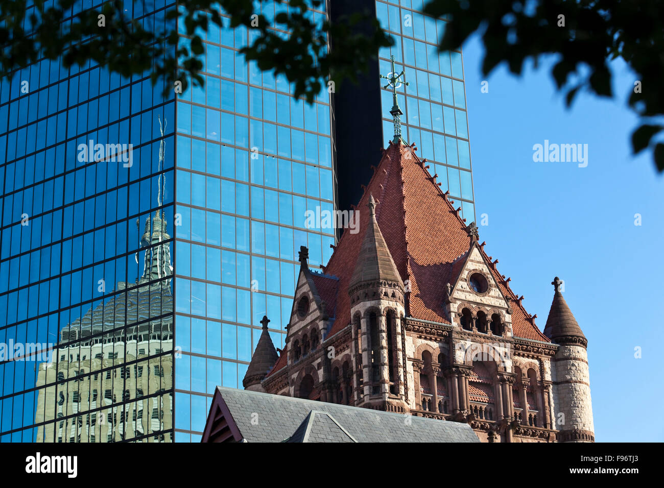 In the foreground is the central tower of Boston's Trinity Church, a National Historic Landmark located in Copley - Stock Image