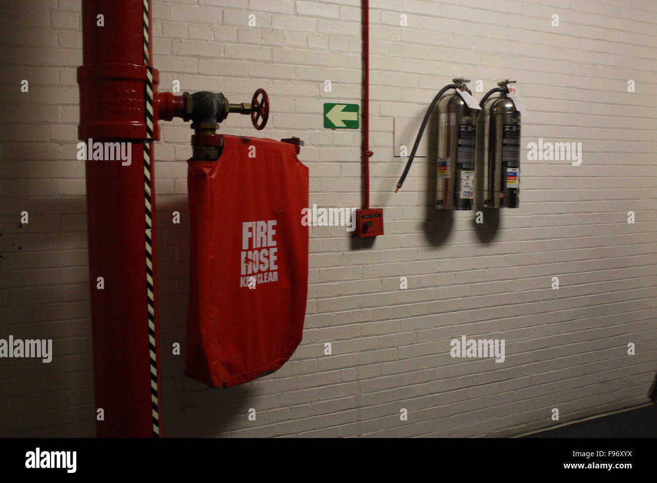 Fire Control And Safety Equipment Mounted On A Wall - Stock Image