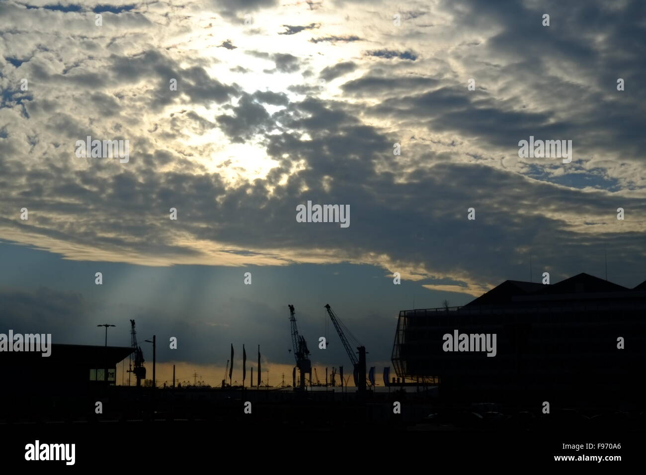 Cranes And Cloudy Sky At Sunset - Stock Image