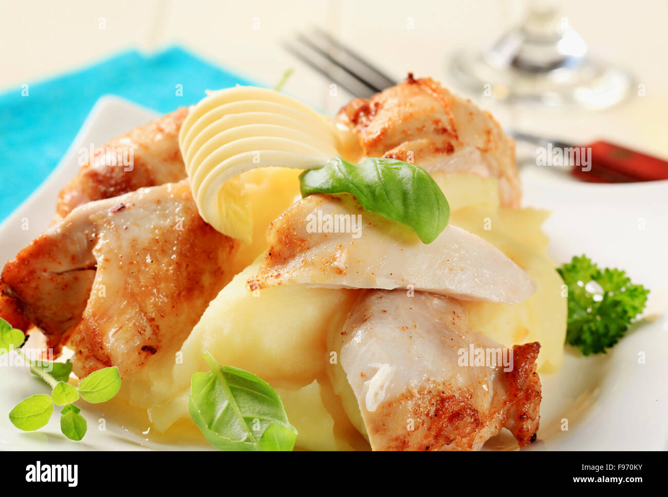 Pieces of roast chicken with mashed potato - Stock Image