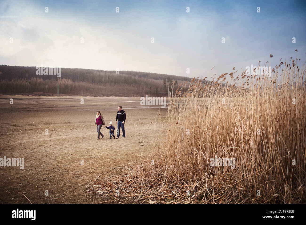 Happy young family spending time together in nature. Stock Photo