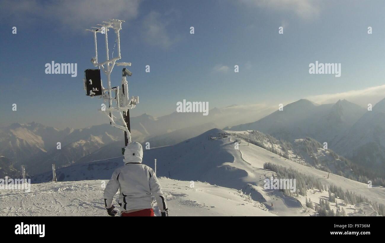 Tourist Wearing Skiwear At Top Of Mountain - Stock Image