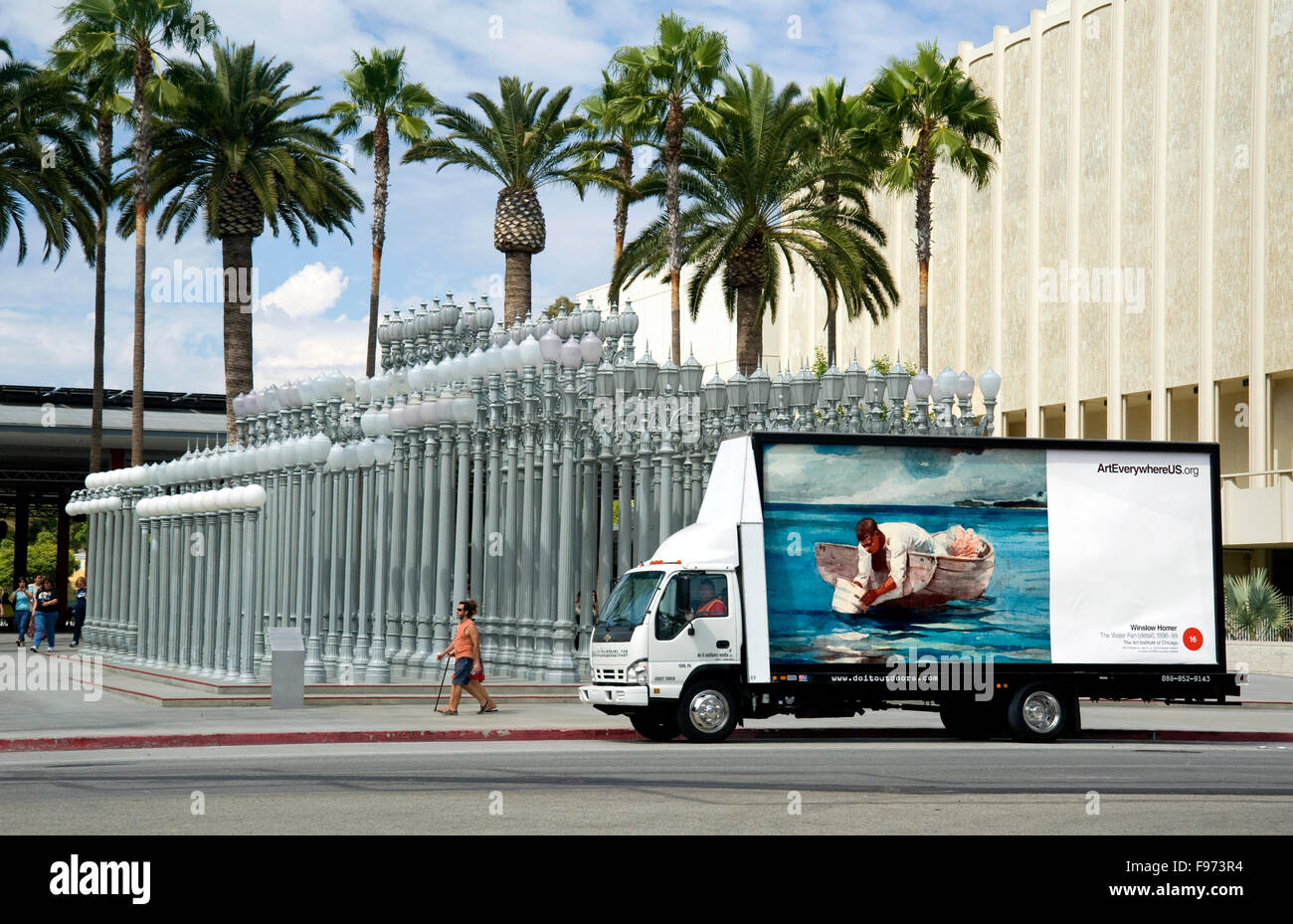 A Winslow Homer Painting Is Reproduced On Mobile Billboard Passing In Front Of The Urban Light Installation At Los Angeles County Museum Art During