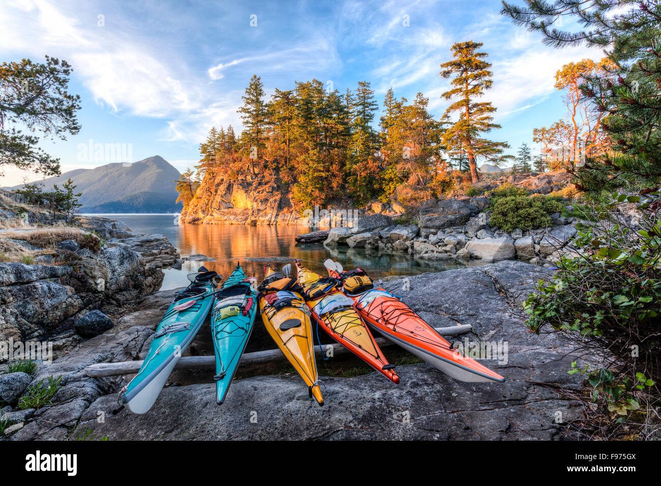 Kayaks rest just above the high tide mark on West Curme Island in Desolation Sound Marine Park. British Columbia, - Stock Image