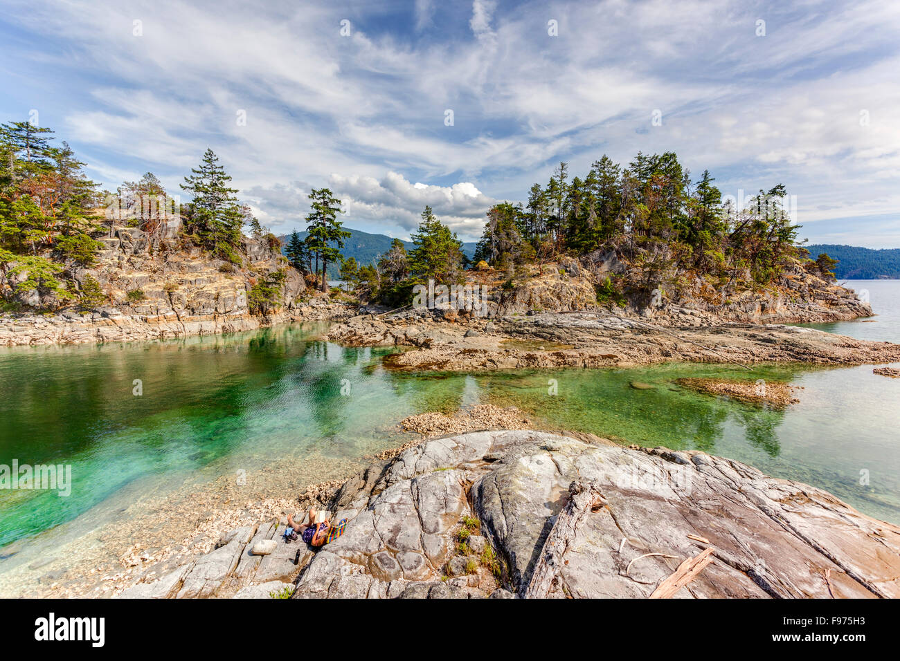 The view from West Curme looking towards East Curme Island at low tide. Desolation Sound Marine Park, British Columbia, - Stock Image