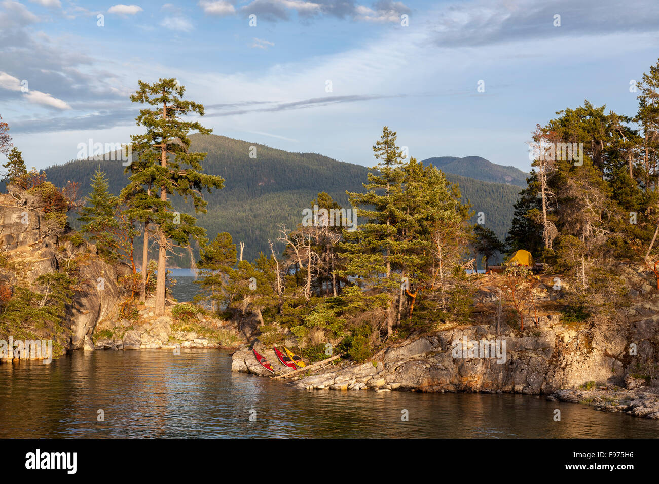 High tide separates East Curme from West Curme Island in Desolation Sound Marine Park. British Columbia, Canada. - Stock Image