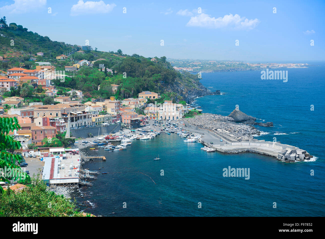 Sicily cove, view in summer of the secluded bay of Santa Maria della Scala, near Acireale in Sicily. - Stock Image