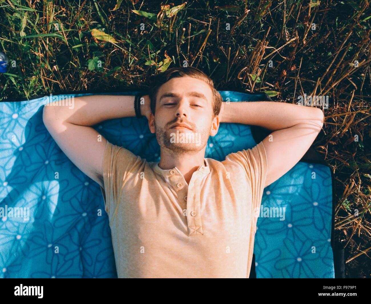 High Angle View Of A Man Lying Outdoors - Stock Image