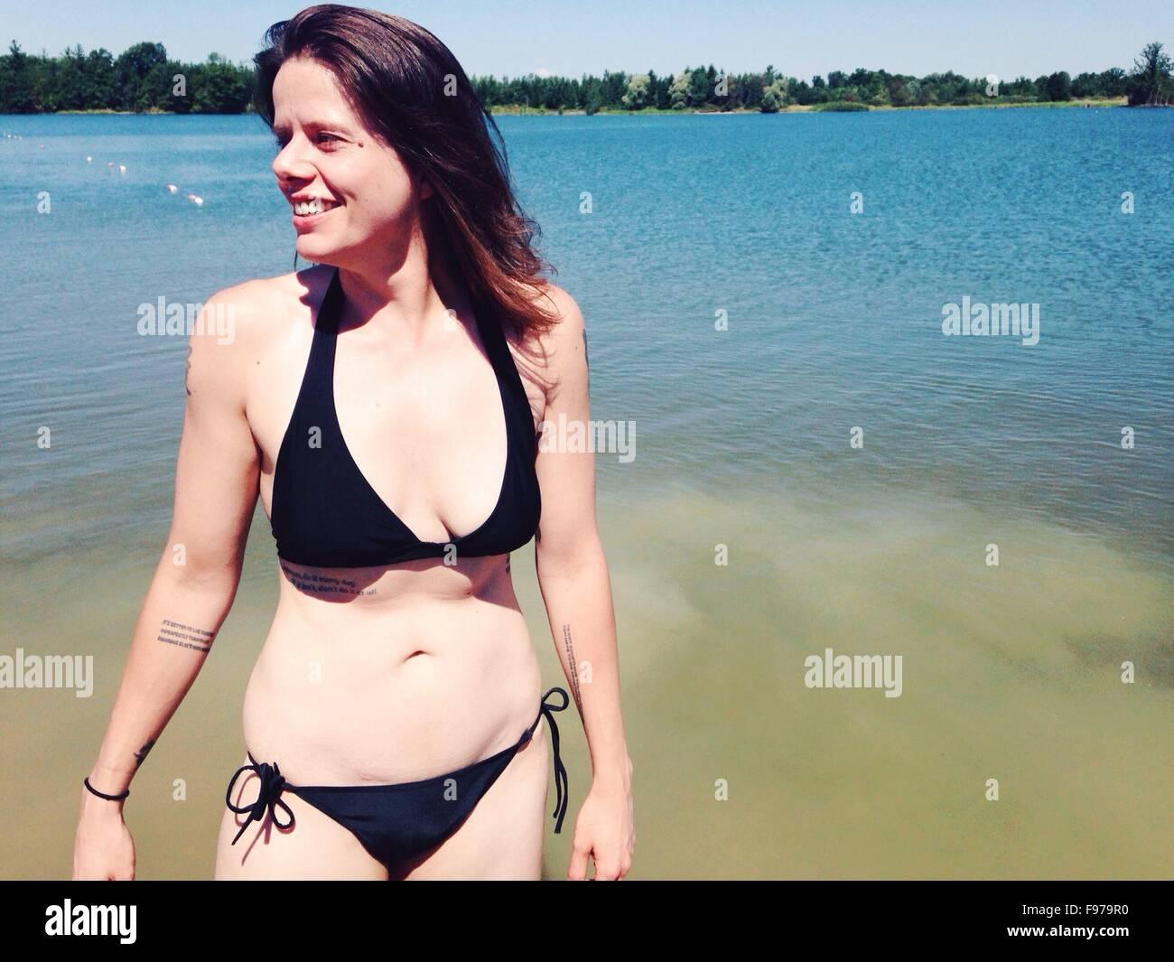 Beautiful Woman In Bikini With Sea In The Background - Stock Image