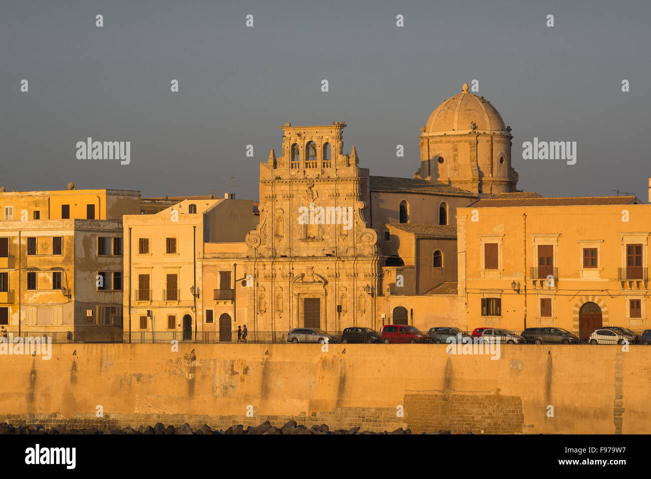 Syracuse Sicily, sunset view of the Church of Santo Spirito sited on the eastern sea wall of Ortigia island, Sicily. - Stock Image