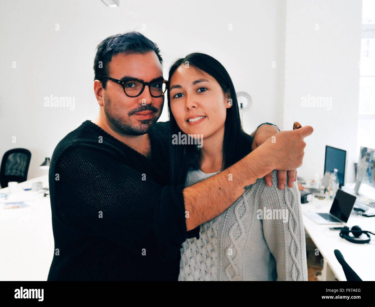 Portrait Of Smiling Mid Adult Couple Standing In Office - Stock Image