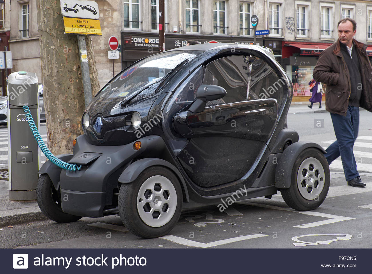 Public electric car charging point, Paris Interested passerby - Stock Image