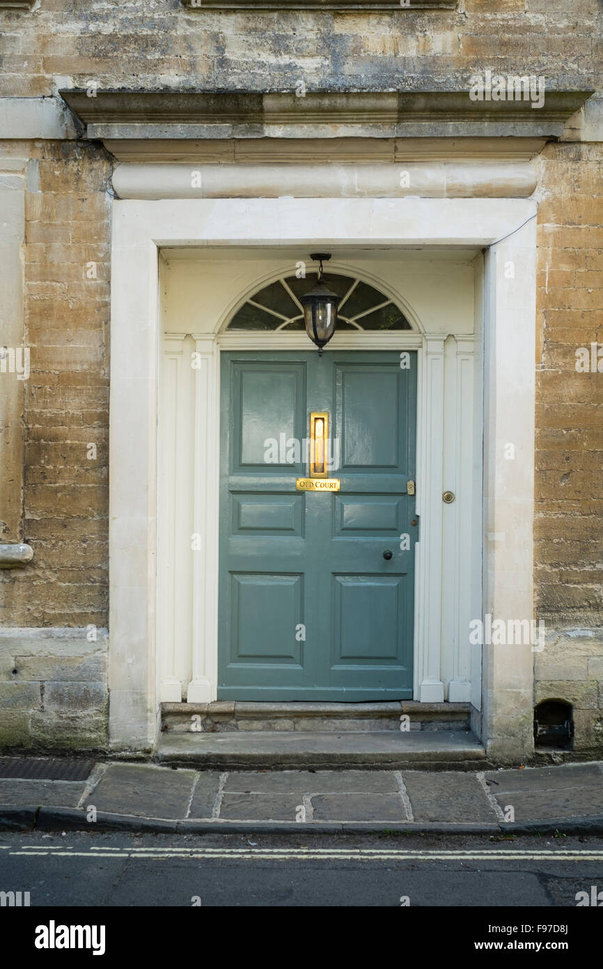Architectural details: A classically proportioned ornate doorway , 6 panel door, and fan light at the entrance to - Stock Image