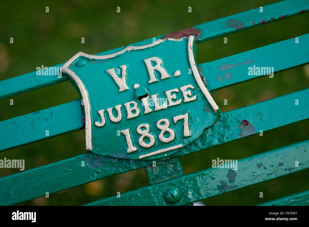 VR (Victoria Regina - Queen Victoria) 1887 jubilee memorial plaque on a park bench in Cirencester, Gloucestershire, - Stock Image