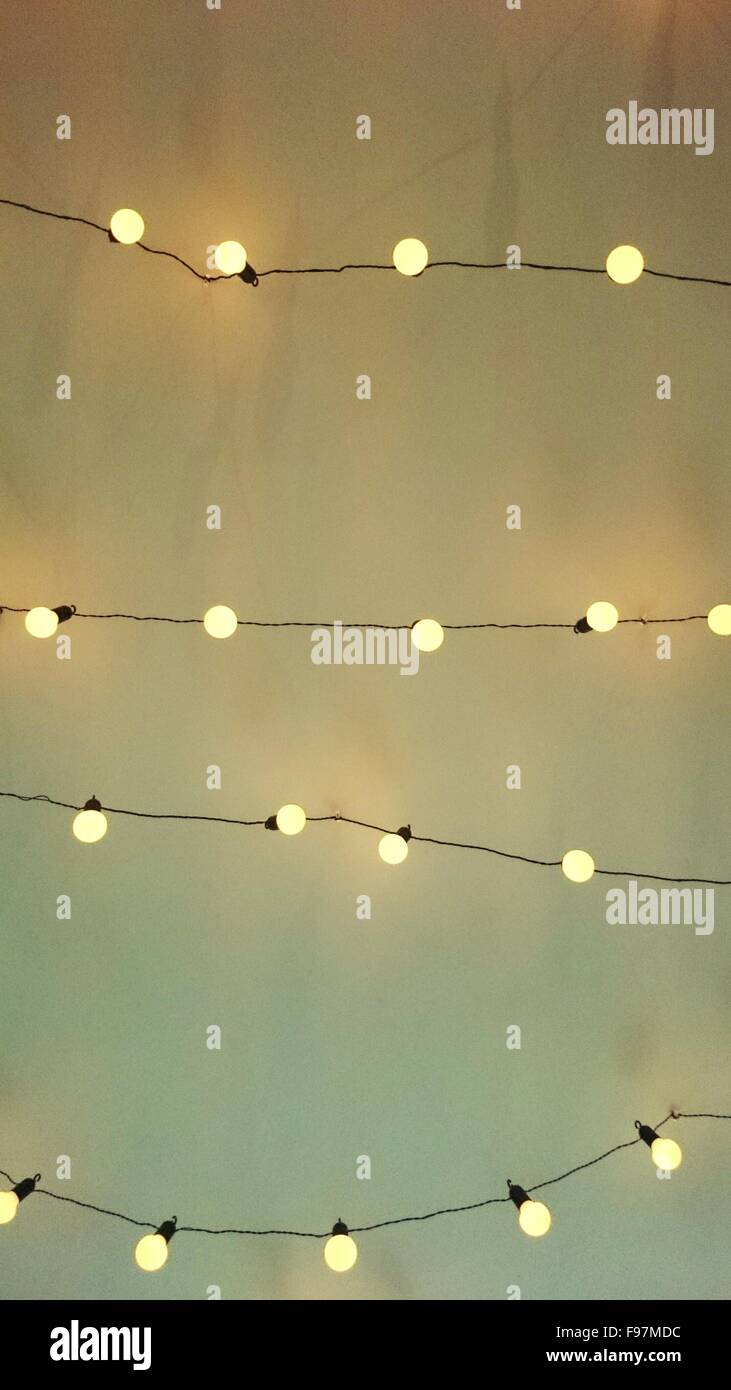 Low angle view of fairy lights against white wall stock photo low angle view of fairy lights against white wall aloadofball Choice Image