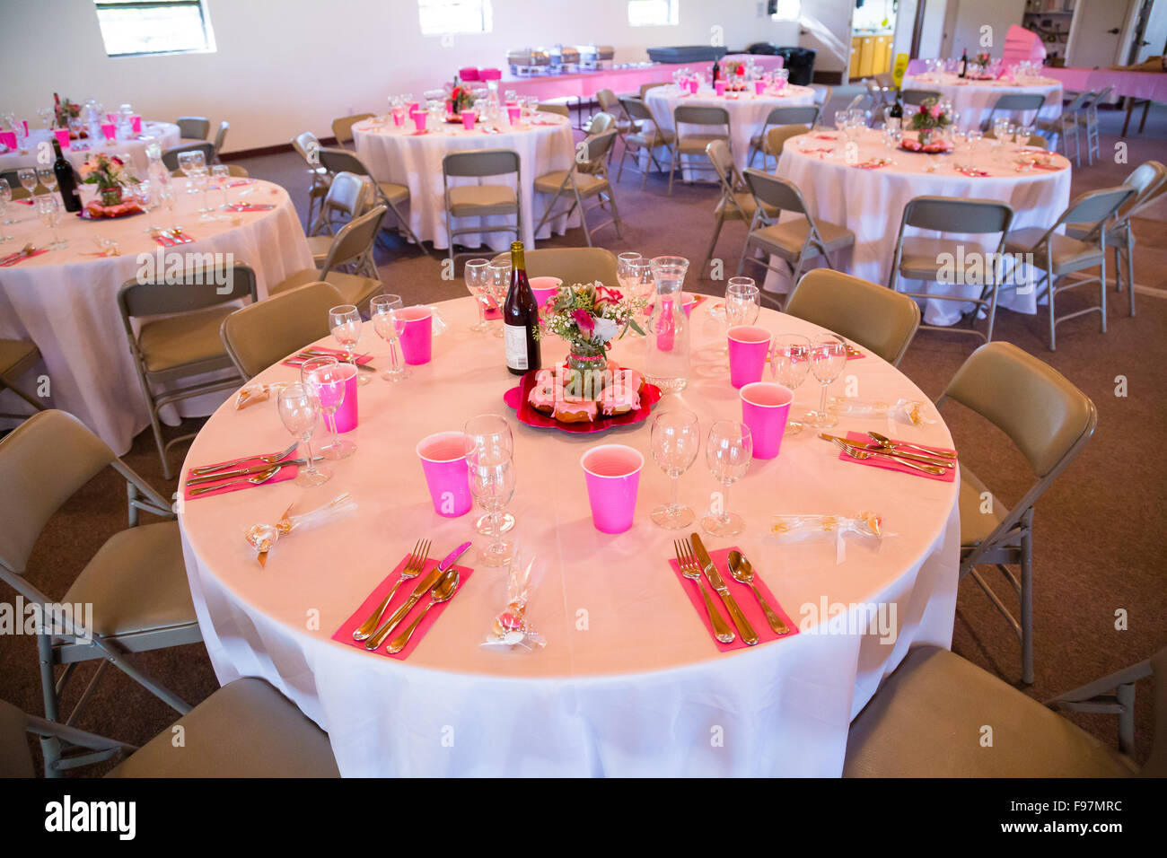 Details at a wedding reception include pink decor and donuts Stock ...
