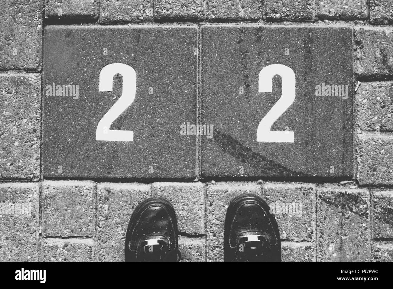 Double Number Two And Man's Feet - Stock Image