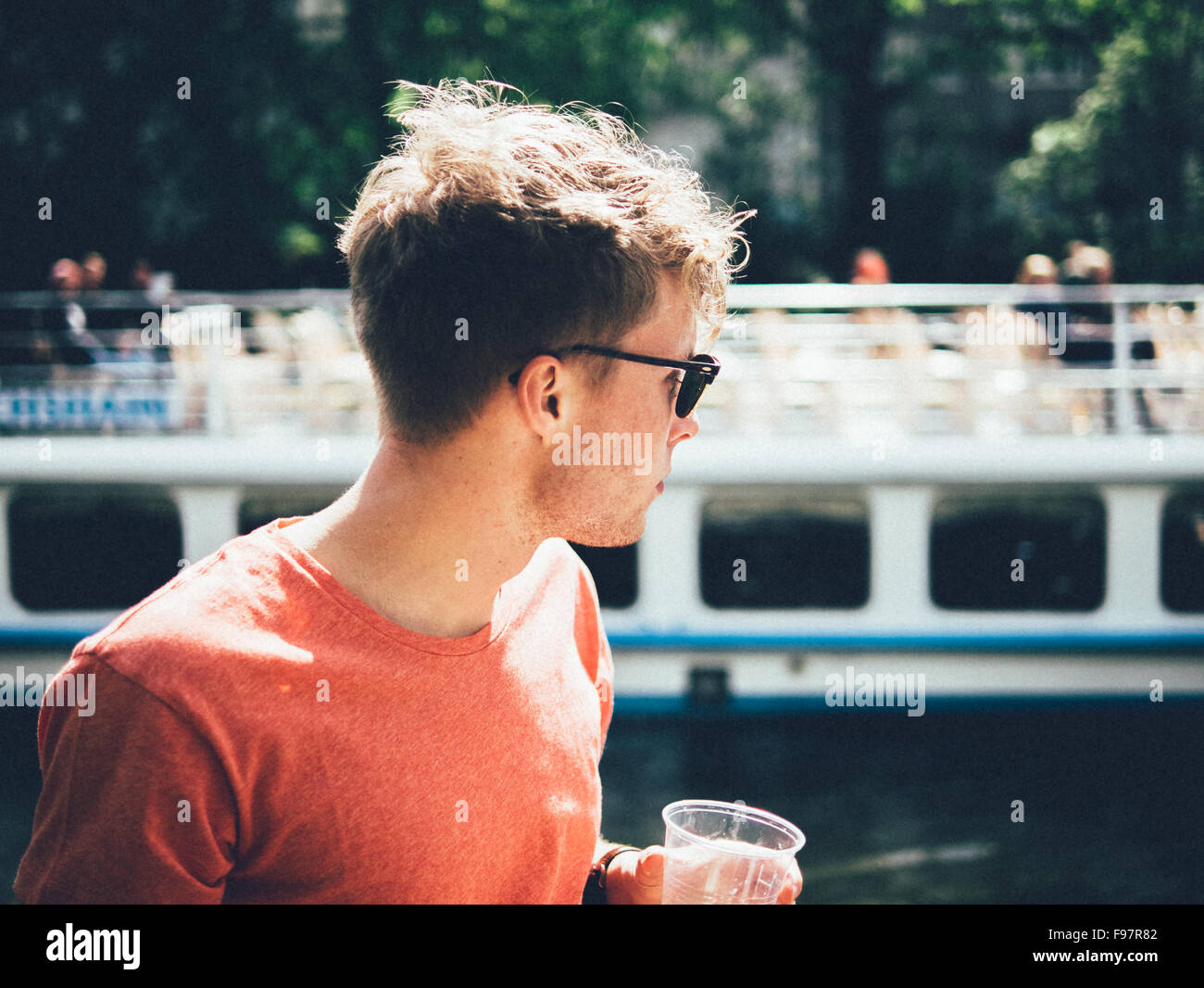Man Wearing Sunglasses While Standing By Canal - Stock Image