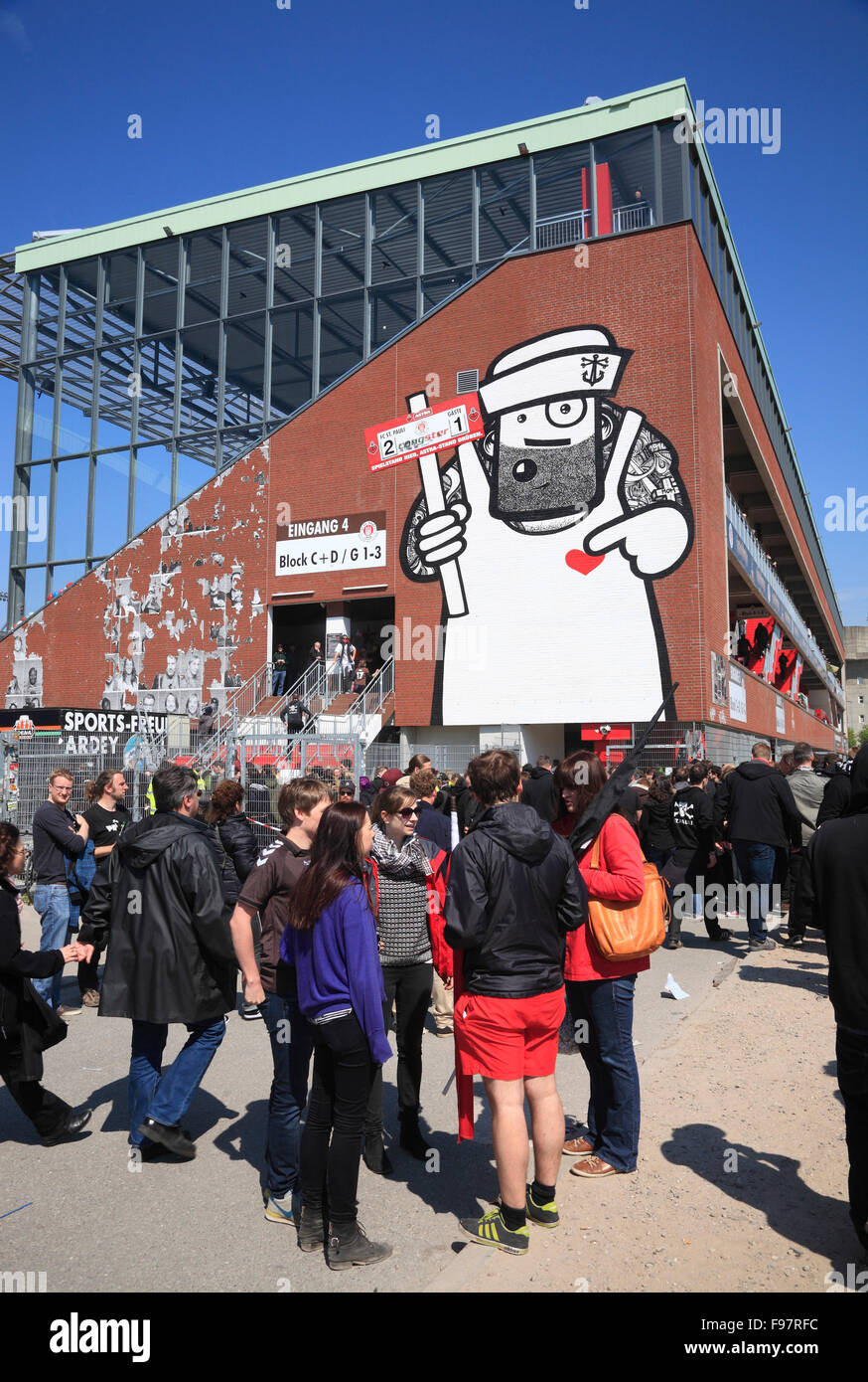 Fans of FC St. Pauli football club at Millerntor Stadium, St.Pauli, Hamburg, Germany, Europe - Stock Image