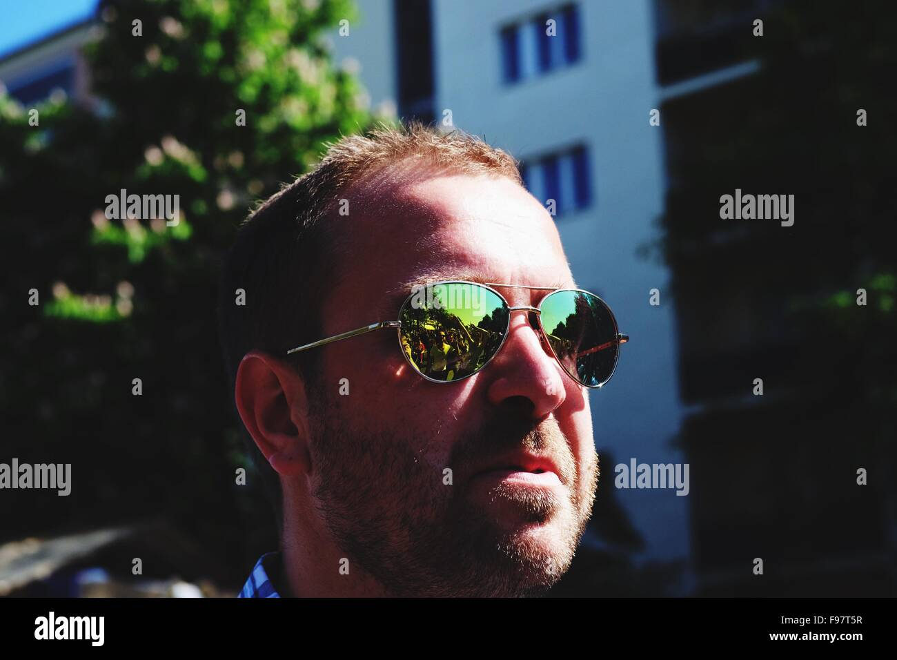 Man Wearing Sunglasses In City Against Building - Stock Image