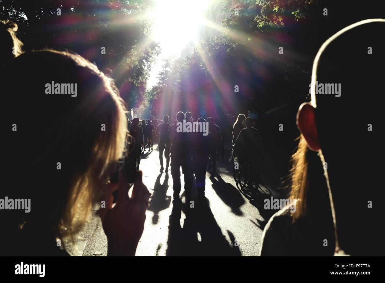 Silhouette People Walking On Road Stock Photo