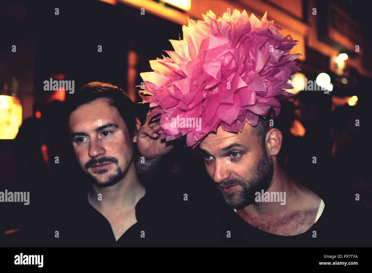 Friends Looking Away At Nightclub - Stock Image